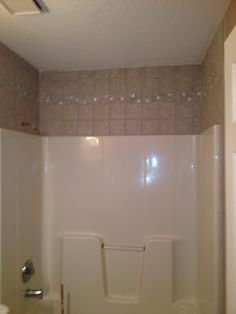 Fiberglass Tub Shower With Tile Surround Above Matching