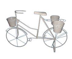 Bicicleta de hierro con 3 portamacetas