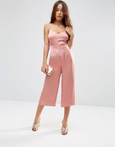Meet the fancy jumpsuit that will take you from ceremony to reception in one chic move. Sensible at the front and sassy at the back, all you need to do is add a jacket and mule combo