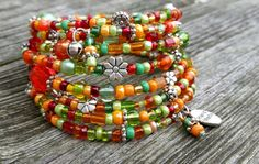 Orange, green and red glass beads on memory wire