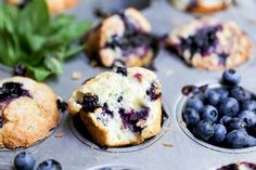 A recipe for blueberry muffins with fresh basil and a homemade blueberry-basil sauce.