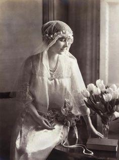 Queen Elizabeth (nee Bowes Lyon) wearing her long bridal veil of old point de Flanderes lace (1923)
