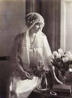 Queen Elizabeth (nee Bowes Lyon) wearing her long bridal veil of old point de Flanderes lace (1923)