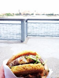 Ramen.Co - Like the Cronut, this game-changing mash-up hasn't been on the New York City food scene long. But since its 2013 Smorgasburg debut, the demand has been astronomical--so much so that it inspired a full-fledged restaurant, Ramen.co, in the Financial District. Safe to say, it's not leaving NYC anytime soon. 191 Pearl St. (at Cedar St.); 646-490-8456 or ramenburger.com The NYC Food Bucket List via @PureWow