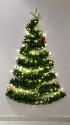 Looking for Christmas decoration for small space. Then you should definetly put up a wall Christmas Tree. Here are best DIY Wall Christmas tree ideas. Wall Christmas Tree, Creative Christmas Trees, Easy Christmas Decorations, Modern Christmas Decor, Noel Christmas, Simple Christmas, Christmas Crafts, Christmas Ornaments, Christmas Tree Out Of Lights