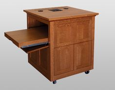 MWSFP-29 Evidence Cart in Quarter Sawn White Oak - Open on Left. This little workstation has a side shelf that can be opened to either side to accommodate right and left handed presenters. #Infocomm2012