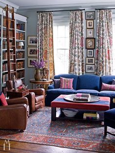 Room of the Day ~ royal blue sofa and like the vertical stack of art in this colorful library ~ Mona Hajj design 9.21.2014