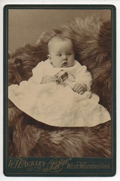 Cabinet Card #Photograph of a #Victorian baby, holding a rattle.
