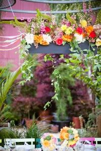 The hanging flower box over the wedding party table