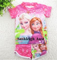 Frozen Swimwear  Frozen inspired Swimwear. Picture of Elsa and Anna on the front. (Rashie Top) On the shorts, which is the same material, is also a picture of the girls. Quick dry material.