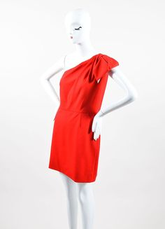 Short party dress in classic Valentino red is lined. Side zipper with hook & eye closure.?í´íë_Woven stretch wool blend. One strap over left shoulder with pleated half-bow. Angled neckline. Mid-thigh