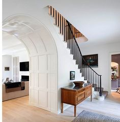 """""""We're decorating a gorgeous home in L.A., and this was one of our first inspiration pictures. The contrast of the light floors against the ebony staircase railing is just perfection."""""""