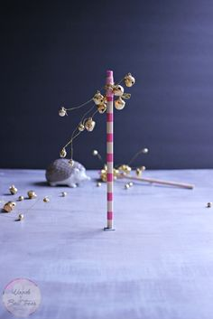 Craft these pencil bell trees, they're great little whimsical trees perfect for a DIY Christmas village of illuminated houses! Fun unique, holiday decor!
