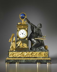 c1775 - 85 A Louis XVI mantel clock a scene representing the death of the great mathematician Archimedes being slain by a Roman soldier, the plinth sides mounted with winged ribbon-tied wreathes, to the right of the clock is Geometry personified represented by a beautiful seated classical maiden wearing loose drapery.