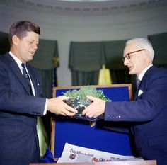 President John F. Kennedy receiving a bowl of shamrocks from the Irish ambassador.