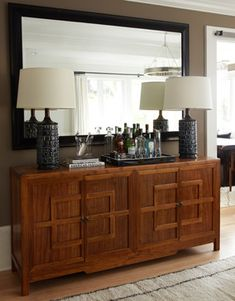 The Cure for Houzz Envy: Dining Room Touches Anyone Can Do | Set up the bar. - Whether you're using a bar cart or buffet, leaving the bar set up means you'll draw people to an underused dining room space even when you're not serving a formal sit-down dinner.