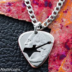 Guitar Pick Necklace, Hand cut and burnished Quarter – NameCoins Music Note Necklace, Guitar Pick Necklace, Necklace Set, Coin Jewelry, Unique Jewelry, Custom Guitar Picks, Guitar Gifts, Unique Guitars, Stainless Steel Chain