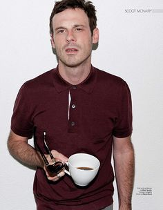 SCOOT MCNAIRY sun glasses and a cup of coffee.