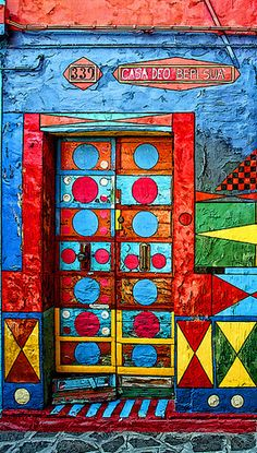 I would love to enter a place by walking through such a colorful doorway! :) If you have any questions at all about windows or doors, feel free to contact us - just answers, no sales (unless that's what you're asking for :-) Cool Doors, Unique Doors, Entrance Doors, Doorway, When One Door Closes, Knobs And Knockers, Door Gate, Closed Doors, Painted Doors