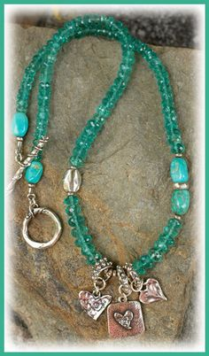 Sea of Joy Necklace... IN THE MIX Sea blue Apatite with Rare Fox Mine Turquoise and Artisan Handcrafted Silver charms, toggle & accents necklace length.......17.5 inches An Original Handcrafted Necklace by Cathy Dailey