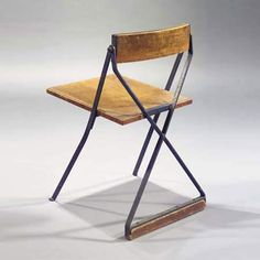Design Jan Duiker. Launched in 1929-1930. Designed as a chair for teachers at the Openluchtschool (open-air school), from architect Duiker, at the Cliostraat in Amsterdam. The square seat and shaped back rest set in a blue lacquered frame.