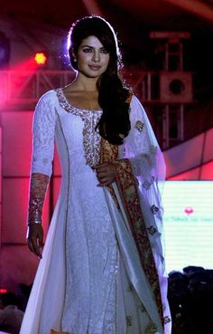 Indian Bollywood film actress Priyanka Chopra walks the ramp during the seventh annual Pidilite-CPAA Charity Fashion Show showcasing designers Manish Malhotra and Shaina NC in support of the Cancer Patients Aid Association (CPAA) in Mumbai on July 1, 2012.