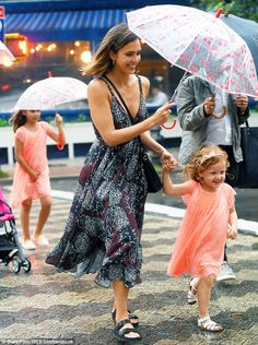 Splashing around: The trio dashed through puddles as they headed across the road together...