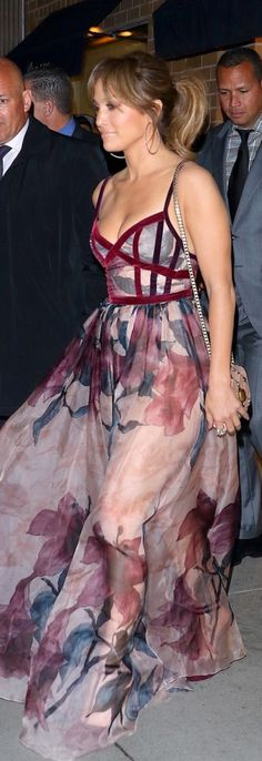 Who made Jennifer Lopez's pink floral velvet gown and pink bag?