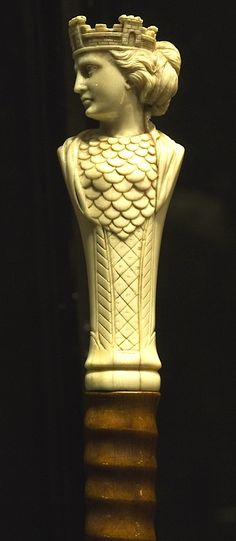 Walking cane with an ivory top presenting a beautiful Queen with head turned wearing a crown in the shape of a castle. Period circa 1880.