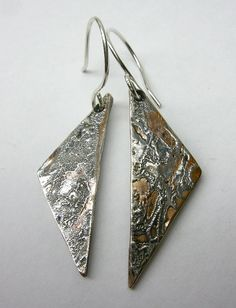 Mokume Gane is an ancient Japanese technique. Silver and copper and soldered and forged to imitate wood textures. I make the mokume gane myself, textures can vary from one piece to the other.Length: 3cmAll my jewelry is handmade in my studio, using top quality materials. My creations are mad...