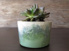 A pot that's ready for anything you throw at it: Plants, candles, decorative pine cones… You know, anything. | 25 Surprisingly Sleek Ways To Decorate With Concrete