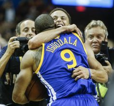 Golden State Warriors' Stephen Curry and Andre Iguodala celebrate after Game 6 of The NBA Finals between the Golden State Warriors and Cleveland Cavaliers at The Quicken Loans Arena on Tuesday, June 16, 2015 in Cleveland, Ohio. The Golden State Warriors defeated the Cleveland Cavaliers 105 to 97 to win the NBA Finals title 4 games to 2. Photo: Scott Strazzante, The Chronicle