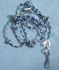 """Approximately 32"""" long. Silver spacer beads, iridescent peacock bugle beads, & pieces of iridescent abalone shell (I think - some kind of shell anyway). I always include a strong magnetic safety clasp on this kind of lanyard. So much nicer than th..."""