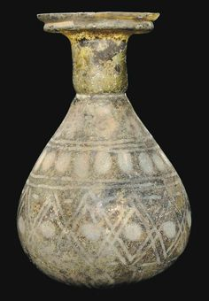 A ROMAN GREEN GLASS SPRINKLER FLASK CIRCA 4TH CENTURY A.D.