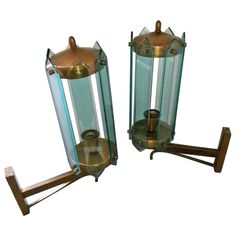 1950s Pair of Arredoluce Wall Lights | From a unique collection of antique and modern wall lights and sconces at https://www.1stdibs.com/furniture/lighting/sconces-wall-lights/