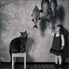 girl with cat and fish.  andy prokh