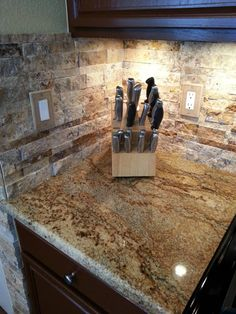 """Kitchen Updating: Painted Sherwin Williams """"Fiery Brown"""" paint on cabinets, stainless steel appliances, Golden Crystal granite countertops from Arizona Tile, Scabos Split 3-D Mesh Mount Stacked Natural Stone backsplash from Arizona Tile, sink, faucet, and under the cabinet lighting"""