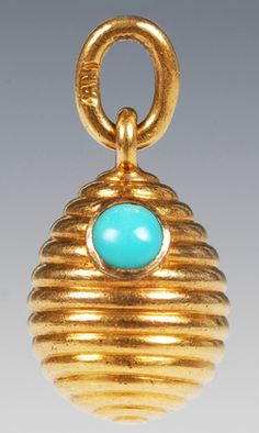 A Faberge gold pendant egg, workmaster August Holmstrom, St Petersburg, prior 1899. The spiraling egg set with two turquoise stones. John Atzbach.