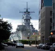 The BATTLESHIP USS Wisconsin makes a very intimidating backdrop,at the end of this street in Norfolk,Virginia