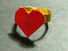 Video on how to make an oragami heart ring out of one piece of rectangular paper