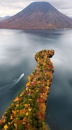Autumn leaves are awash in colors on Hatchodejima, a peninsula that juts into Chuzenjiko lake, in Nikko, Tochigi Prefecture, on Oct. 26. Seen in the background is Mount Nantaisan.