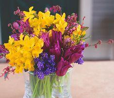 Daffodils, Muscari and tulips with purple Loropetulum and heather. #design #flowers