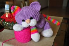 Colourfull amigurumi cat.