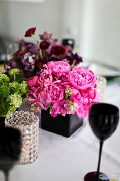 Bright pink and black centerpiece. Find more ideas for how to plan an 80s party http://sparklerparties.com/rock-the-80s/