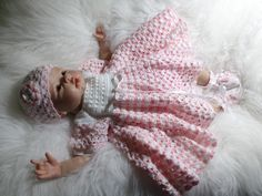 done in two ply pink and white crochet cotton with extra full skirt