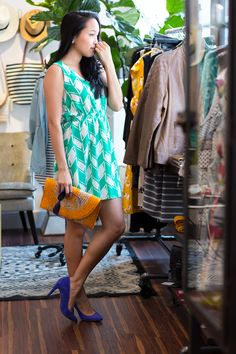 Blue Dolce Vita heels, a mustard yellow straw bag, and a lightweight green chevron summer dress on Lace and Combat Boots.