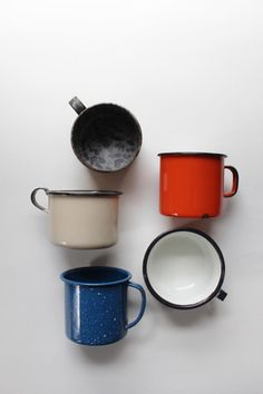 Vintage enamelware camping mug set of 5. Vintage color hues. White, red, blue mugs.