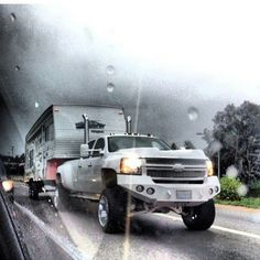 For being shot through a window that's an awesome pic. The white truck looks cool against the dark clouds