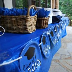 How To Throw A Great Graduation Party~I really like the decorations on this food serving table!