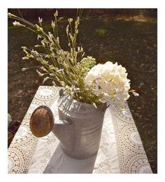 Love the flowers in an old tin watering can. This will be perfect for the picnic table outside our kitchen window.